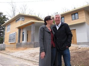 Marsha Gordon and Louis Cherry in front of their new home. AP Photo