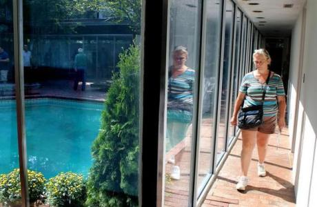 Dorothee Thielisch of Chapel Hill walks down a hallway during a tour Saturday of Modernist architect Arthur Cogswell's home on North Elliott Road. (N&O photo)