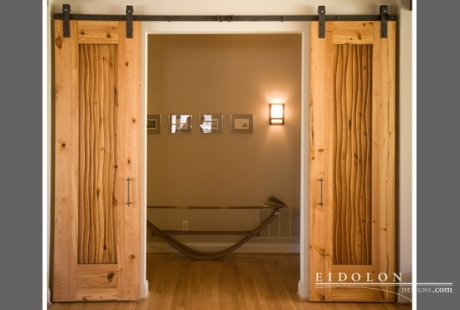 "Eidolon's ""Slider 1"" overlay doors, handcrafted out of 100-year-old heart pine."